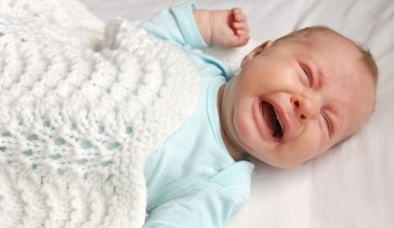 crying-baby-in-crib-suffering-from-colic