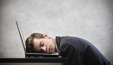 fatigue-and-low-energy-with-man-asleep-on-laptop