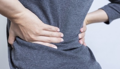sciatica-pain-woman-holding-lower-back