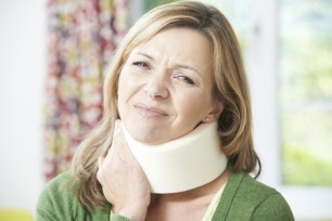 woman wearing neck brace from car accident injury