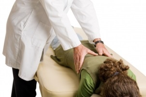 chiropractor performing orthogonal adjustment on patient